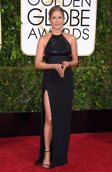 At The 2015 Golden Globes In A Sequined Saint Laurent Halter Gown