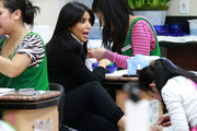 Kim Kardashian makes a silly face as she gets a manicure and pedicure at a Beverly Hills nail salon with a friend.