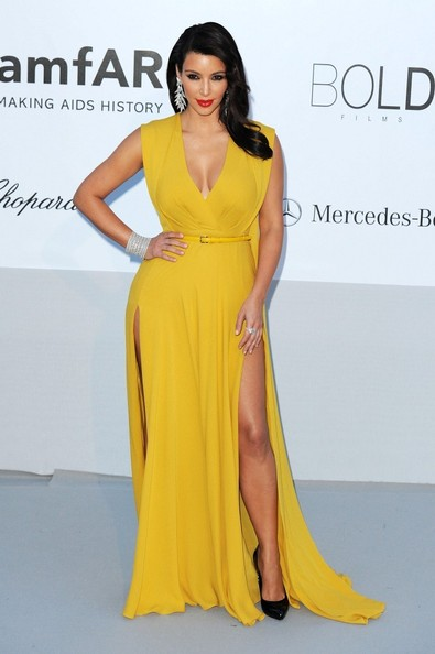 In A Caped Mustard Yellow Gown At Cannes In 2012 See All Of Kim