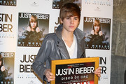 ***NO CANADA RIGHTS***. Justin Bieber receives a gold record for his album 'My World'.
