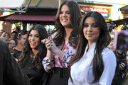 Kim, Kourtney and Khloe Kardashian at The Grove to do an interview with Mario Lopez for the show EXTRA in Los Angeles, CA.