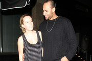 Kendra Wilkinson and Hank Baskett hugging and kissing while on a night out in Hollywood, CA.