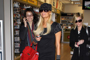 Heiress Paris Hilton stops to buy a couple things before catching a flight to Germany at LAX airport in Los Angeles, CA.