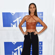 Joan Smalls in a Leather Corset and Zippered Pants