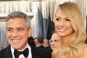 Actor George Clooney (L) and Stacy Kiebler arrive at the 84th Annual Academy Awards held at the Hollywood & Highland Center on February 26, 2012 in Hollywood, California.