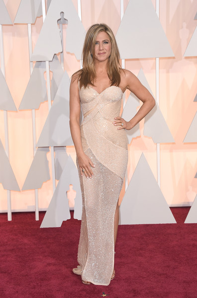 Wearing A Beaded Atelier Versace Gown At The 2015 Academy Awards