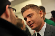 Actor Zac Efron backstage at the Calvin Klein Men's Collection Fall 2011 fashion show during Mercedes-Benz Fashion Week at 205 West 39th Street on February 13, 2011 in New York City.