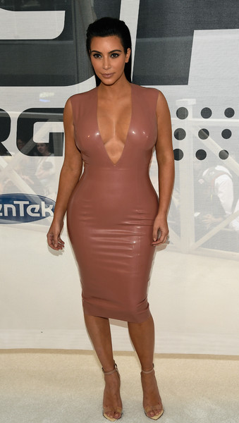 Sporting A Dusty-Rose Latex Dress At A Launch Event