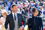 David Beckham  and Victoria Beckham arrive at St George's Chapel at Windsor Castle before the wedding of Prince Harry to Meghan Markle on May 19, 2018 in Windsor, England.
