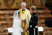Prince Harry and Meghan Markle exchange vows during their wedding ceremony in St George's Chapel at Windsor Castle on May 19, 2018 in Windsor, England.