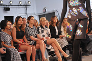 (L-R) Singer Jhene Aiko with actresses Cobie Smulders, Abbie Cornish and Jamie Chung attend the Tanya Taylor fashion show at Industria Studios during Mercedes-Benz Fashion Week on February 13, 2015 in New York City.