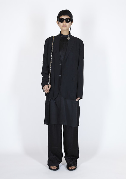 Balenciaga at Paris Spring 2021 [clothing,overcoat,outerwear,standing,fashion,coat,suit,formal wear,eyewear,neck,outerwear,fashion,clothing,standing,wear,overcoat,eyewear,neck,paris fashion week,balenciaga]