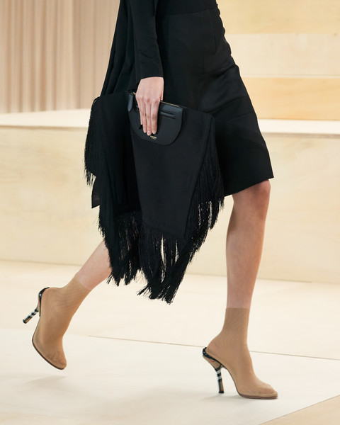 Burberry Prorsum at London Fall 2021 (Details) [shoe,human body,neck,knee,sleeve,waist,thigh,street fashion,flooring,dress,dress,shoe,bikini top,waist,fashion,clothing,abdomen,model,burberry prorsum,london fashion week,little black dress,waist,shoe,fashion,abdomen,clothing,dos gardenias stein square neck bralette bikini top,model,black]