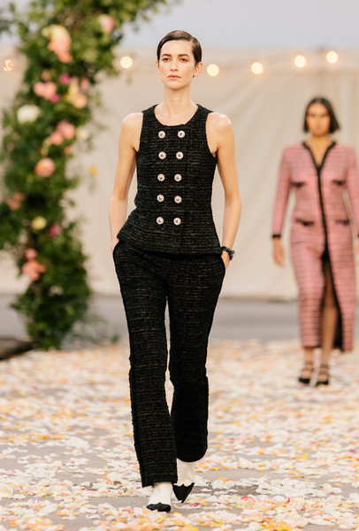 Chanel at Couture Spring 2021 [couture spring 2021,clothing,outerwear,shoulder,street fashion,neck,sleeve,textile,waist,standing,plant,shoe,fashion,haute couture,runway,street fashion,street style,trend,chanel,fashion show,fashion,fashion show,chanel,haute couture,milan fashion week 2020,runway,street style,shoe,trend]