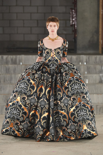 Edward Crutchley at London Spring 2022 [face,hair,dress,fashion,sleeve,runway,waist,street fashion,gown,one-piece garment,gown,fashion,runway,gown,haute couture,street fashion,face,hair,london fashion week,fashion show,fashion,fashion show,gown / m,runway,haute couture,gown]