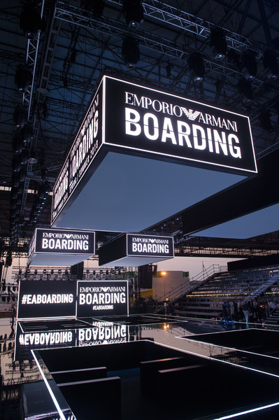 Emporio Armani at Milan Spring 2019 [architecture,sky,sport venue,signage,font,stadium,city,building,scoreboard,fashion,fashion week,signage,font,milan,sport venue,stadium,emporio armani,milan fashion week,fashion show,milan fashion week,milan,fashion,fashion show,fashion week,armani,ready-to-wear,runway]