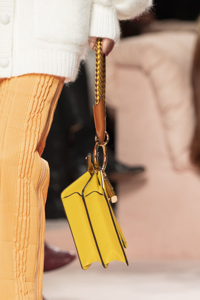Fendi at Milan Fall 2020 (Details) [yellow,fashion,leather,fashion accessory,joint,hand,outerwear,street fashion,beige,fashion design,fashion accessory,handbag,fashion,yellow,street fashion,model,leather,beige,fendi,milan fashion week,handbag,yellow,model,fashion]