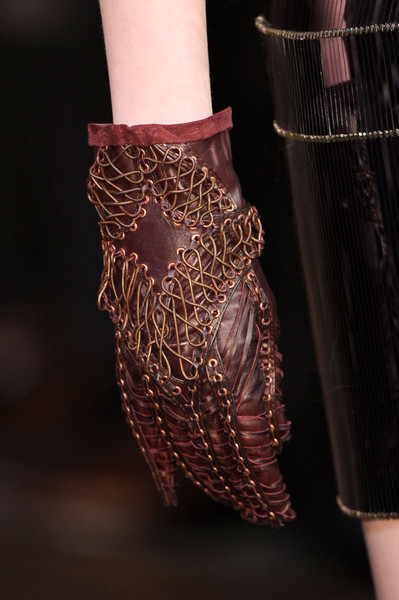 Iris Van Herpen at Couture Spring 2012 (Details) [fashion,joint,arm,leg,hand,fashion accessory,jewellery,human body,footwear,bangle,jewellery,fashion accessory,iris van herpen,fashion,glove,haute couture,leather,clothing,sermoneta gloves,couture spring,jewellery,glove,leather,haute couture,clothing,fashion accessory,fashion,herm\u00e8s,sermoneta gloves]