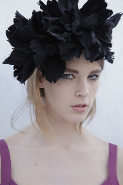 Lanvin at Paris Fall 2011 (Backstage) [hair,headpiece,clothing,hair accessory,hairstyle,beauty,head,feather,fashion accessory,purple,headpiece,size,shoe size,clothing sizes,hair,human height,height,hat,lanvin,paris fashion week,headpiece,marseille,f\u00e9es dhiver,clothing sizes,size,shoe size,hat,human height,height]