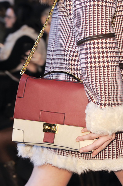 Tommy Hilfiger at New York Fall 2013 (Details) [shoulder,fashion,street fashion,bag,handbag,joint,fur,pink,waist,fashion accessory,handbag,fashion accessory,watch,bag,tommy hilfiger,fashion,haute couture,joint,fur,new york fashion week,handbag,tommy hilfiger,fashion accessory,fashion,pocketcoach gmbh,haute couture,watch]