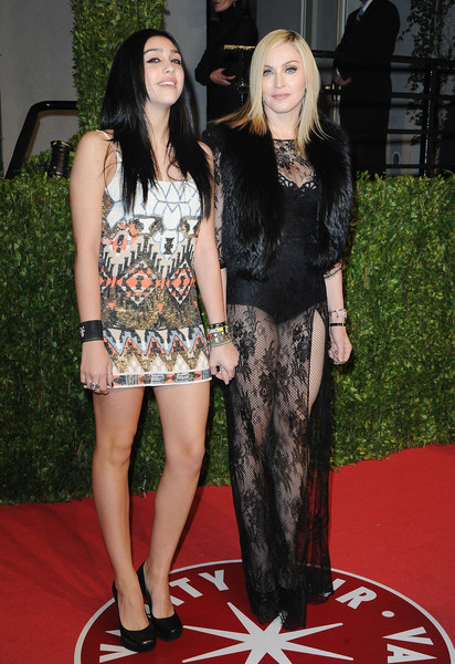 Making An Appearance With Her Daughter In Sheer Black Lace At The 2011 Vanity Fair Oscar Party