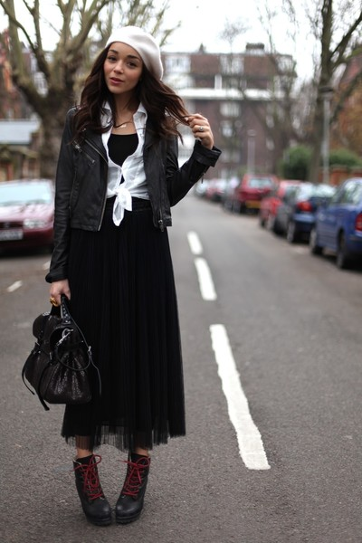 With leather and a feminine skirt.