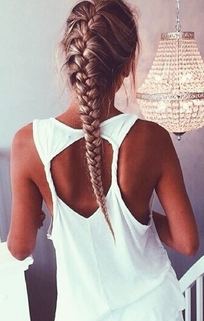 A French braid that tapers down to an elegant point.  Pinned from