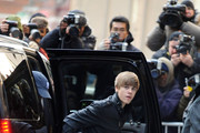 Teen sensation Justin Bieber emerges from a car as he preps to make an appearance on the